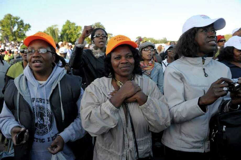 Members of the public take part in the dedication of the Martin Luther King, Jr., Memorial, in Washington, Sunday, Oct. 16, 2011. (AP Photo/Cliff Owen) Photo: Cliff Owen