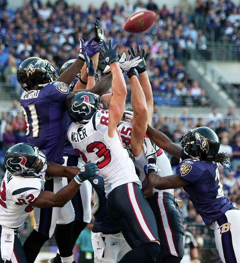 JUMP BALL: Ravens safety Bernard Pollard (31) goes up high to ensure Matt Schaub's pass at the end of the first half doesn't land in the hands of a Texan. Photo: Brett Coomer / © 2011  Houston Chronicle