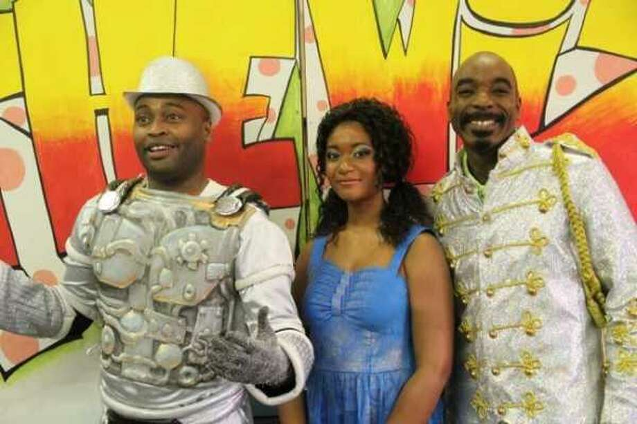 """Dwight Robinson, Symone Johnson and Justin Keown appear in """"The Wiz,"""" a co-production with the Renaissance Guild, for its two-week reprise at the Woodlawn Theatre. Photo: Courtesy Photo"""