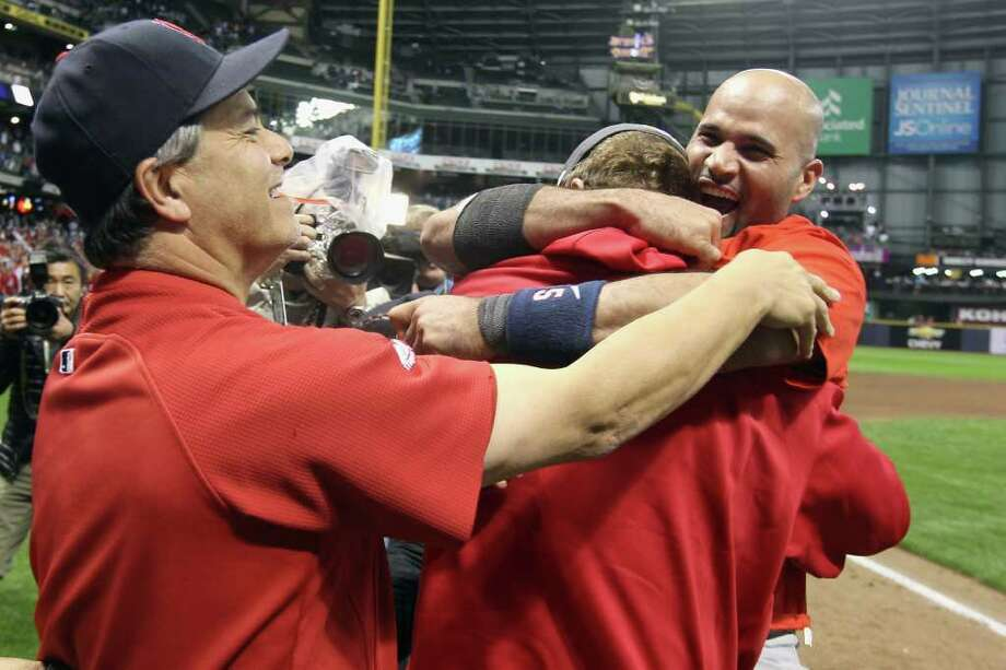 MILWAUKEE, WI - OCTOBER 16:  Albert Pujols #5 (R) of the St. Louis Cardinals celebrates with teammates after they won 12-6 against the Milwaukee Brewers during Game Six of the National League Championship Series at Miller Park on October 16, 2011 in Milwaukee, Wisconsin. Photo: Christian Petersen, Getty / 2011 Getty Images