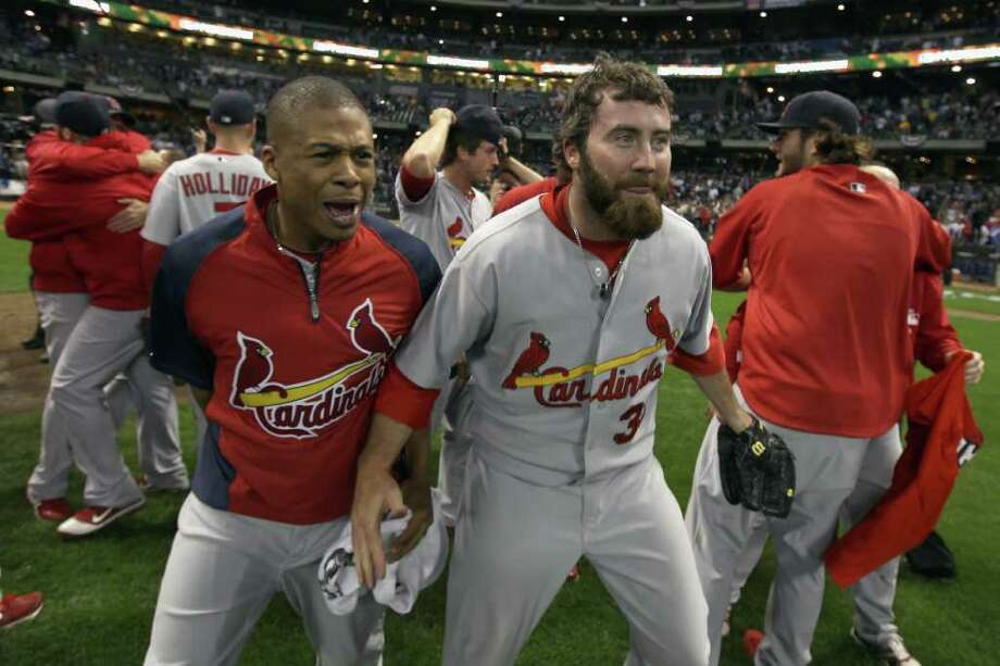 MILWAUKEE, WI - OCTOBER 16:  (L_R) Adron Chambers #56 and Jason Motte #30 of the St. Louis Cardinals celebrate on the field after they won 12-6 against the Milwaukee Brewers during Game Six of the National League Championship Series at Miller Park on October 16, 2011 in Milwaukee, Wisconsin. Photo: Christian Petersen, Getty / 2011 Getty Images