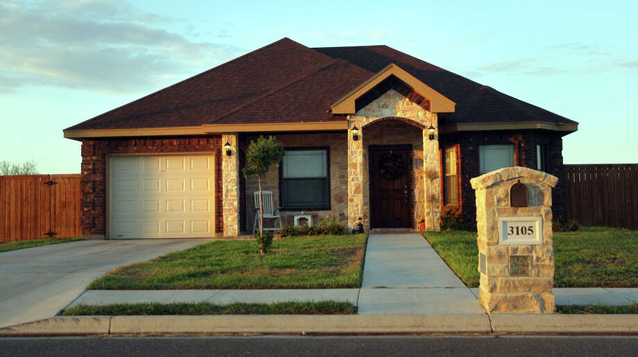 "This home in Alton, near McAllen, was part of a subdivision owned by real estate developer Marin ""Gordo"" Herrera, who was accused in the transfer of more than 660 pounds of cocaine from Mexico to the U.S. This year, Herrera was sentenced to 20 years in prison. Photo: Delcia Lopez/Special To The Express-News / Delcia Lopez Photography"