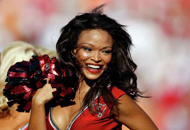 Oct. 16:  A cheerleader of the Tampa Bay Buccaneers performs during the game against the New Orleans Saints at Raymond James Stadium on October 16, 2011 in Tampa, Florida. Photo: J. Meric, Getty / 2011 Getty Images