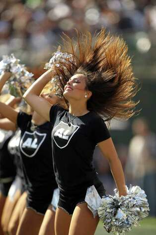 OAKLAND, CA - OCTOBER 16:  Oakland Raiders cheerleaders wear special shirts to honor Oakland Raiders owner Al Davis during their game against the Cleveland Browns at O.co Coliseum on October 16, 2011 in Oakland, California. Photo: Ezra Shaw, Getty / 2011 Getty Images
