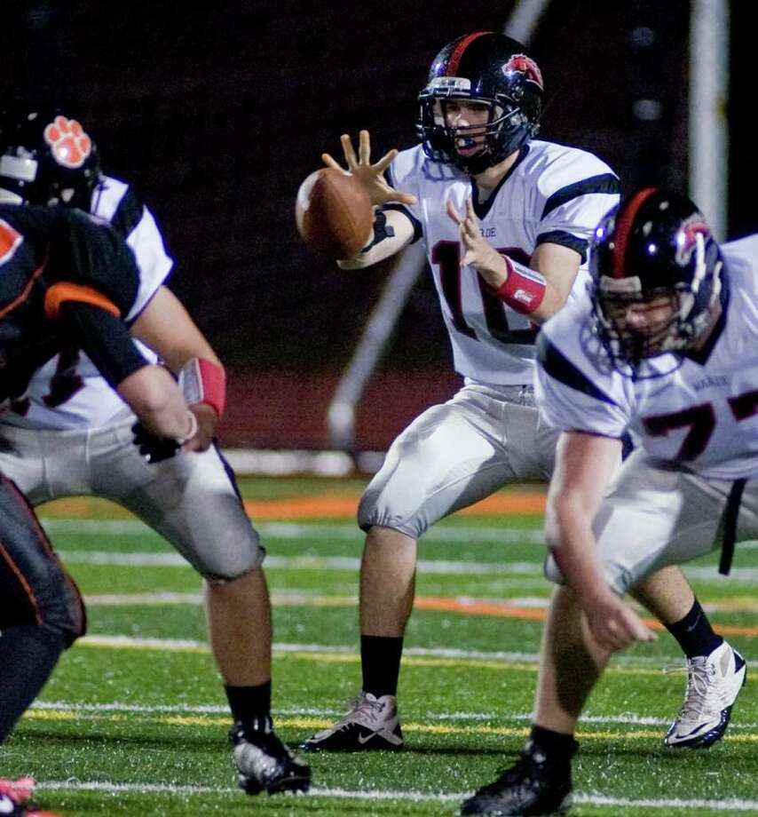 Fairfield Warde's quarterback Chris Foley takes the snap during a football game against Ridgefield High School, played at Ridgefield. Friday, Oct. 14, 2011 Photo: Scott Mullin / The News-Times Freelance
