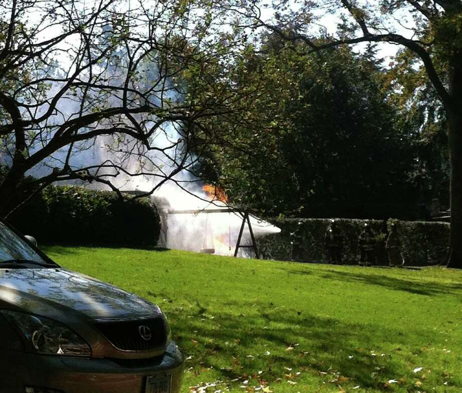 Firefighters battle a fire caused by a ruptured gas line on Gilliam Lane in Greenwich, Conn. on Monday, Oct. 17, 2011. Photo: Lisa Chamoff