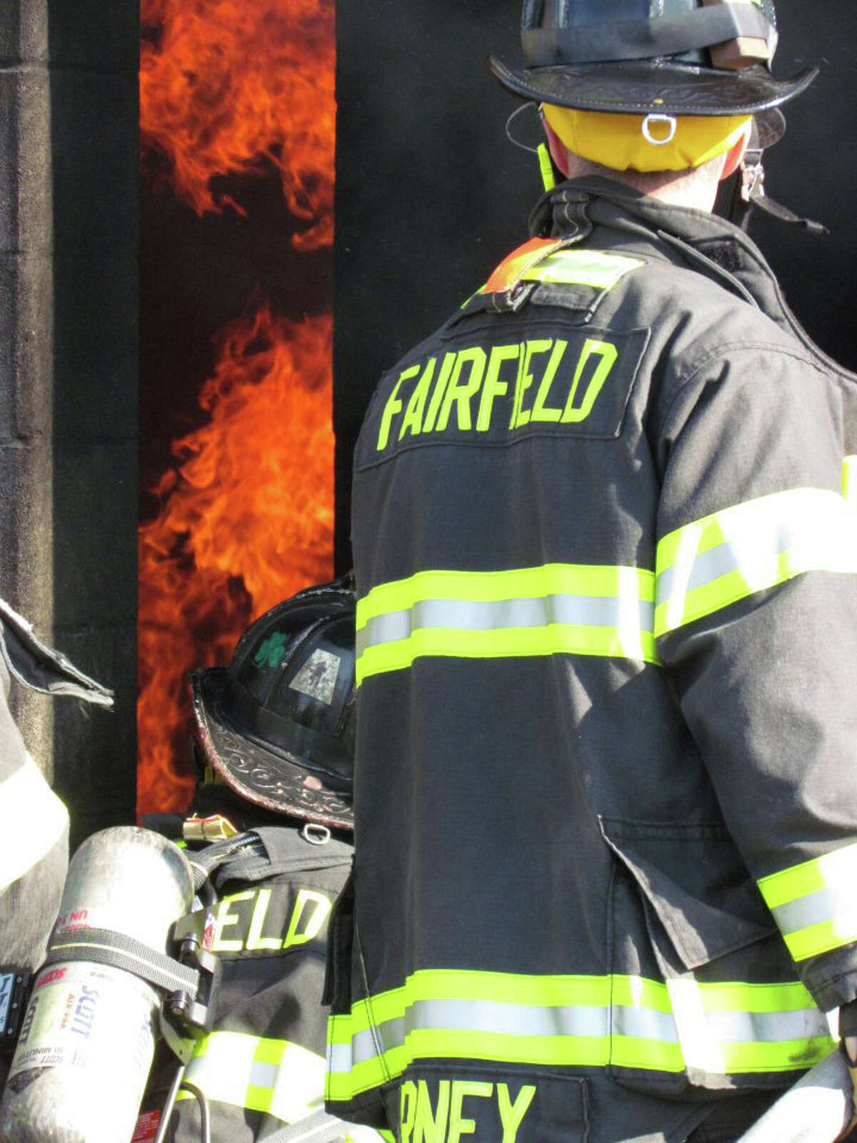 Firefighters tackle a set blaze at the Fairfield fire training center Saturday during FireOps 101.