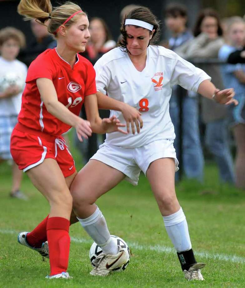 Guilderland's Emily Center (19), left, and Bethlehem's Cassie Smith (8) battle for a ball on the foul line during their soccer game on Thursday, Oct. 13, 2011, at Bethlehem High in Bethlehem, N.Y. (Cindy Schultz / Times Union) Photo: Cindy Schultz / 00014921A