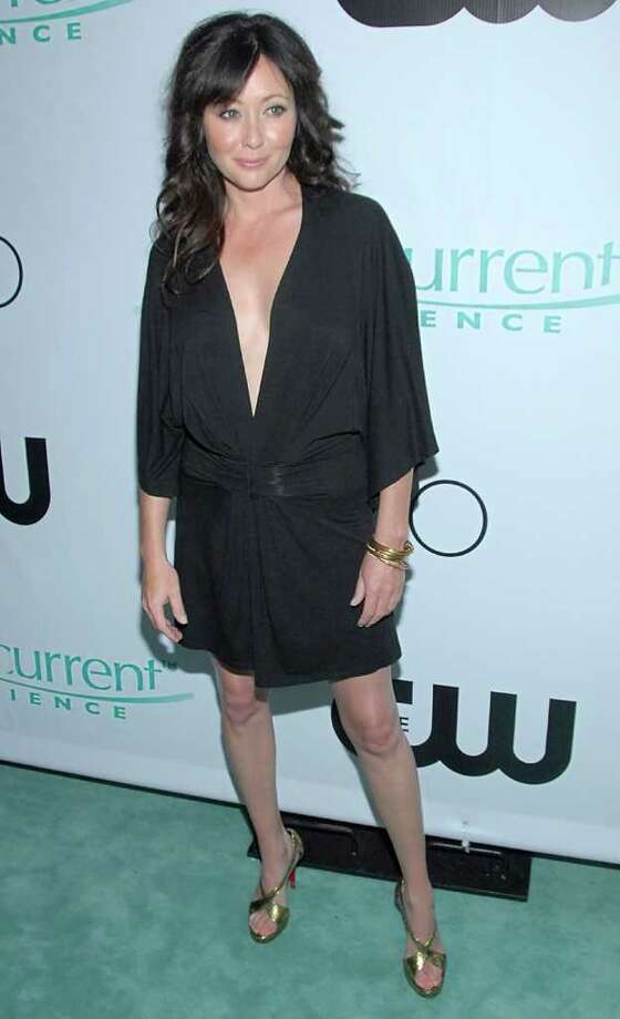 "Actress Shannen Doherty poses on the press line at the premiere party for the new television series ""90210""  in Malibu, Calif. on Saturday, Aug. 23, 2008. Photo: DAN STEINBERG, AP / R-STEINBERG"