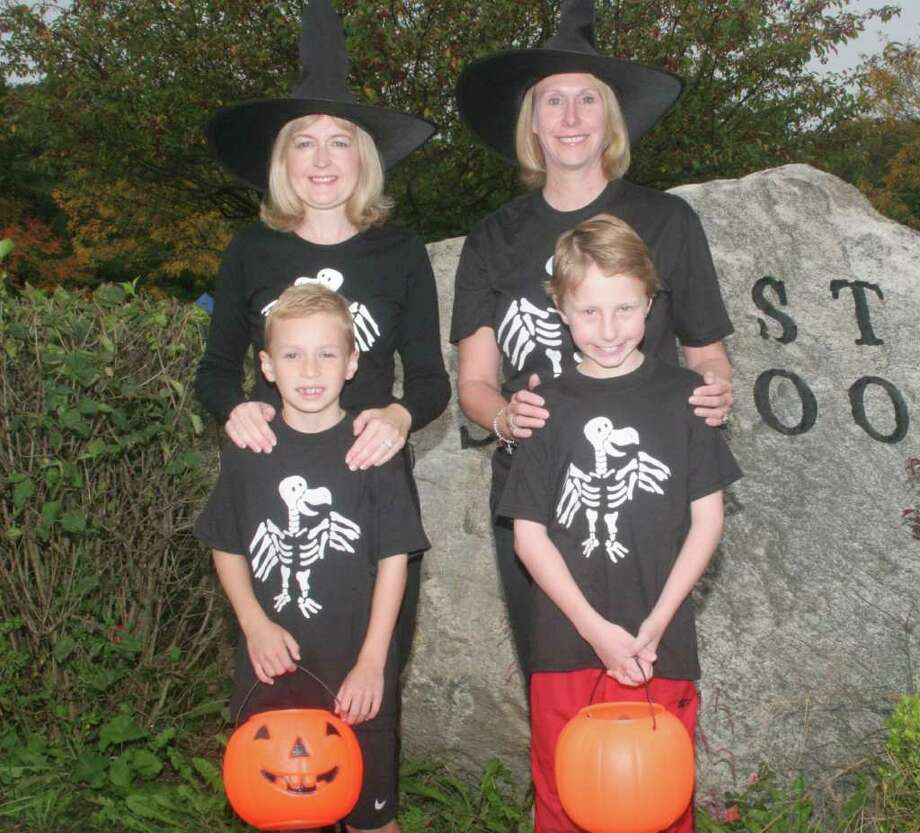 Fall Fair co-chairmen Allison Mennitt with son Liam, left,and Cynthia Peiser with son Matthew, right, are looking forward to this year's Spooktacular. Photo: Contributed Photo