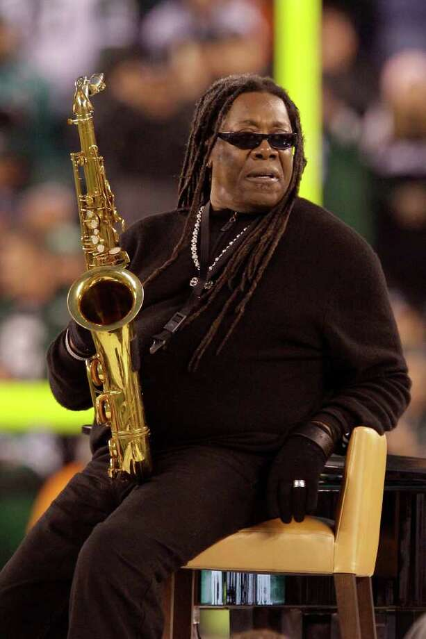 In this Dec. 12, 2010 photo, saxophonist Clarence Clemons performs the National Anthem before an NFL football game between the Miami Dolphins and the New York Jets in East Rutherford, N.J. Two Christmas songs recorded by the E Street Band saxophonist will be released at The Wonder Bar in Asbury Park, N.J., on Nov. 18. Clemons died in June at age 69 after a stroke.  (AP Photo/Kathy Willens) Photo: Kathy Willens