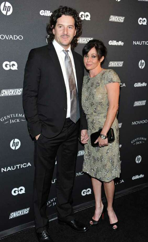 "FILE - In this Oct. 27, 2010 file photo, actress Shannen Doherty, right, and Kurt Iswarienko attend ""The Gentleman's Ball"" hosted by GQ Magazine at the Edison Ballroom in New York. Doherty has married for the third time, wedding photographer Kurt Iswarienko. Doherty's publicist confirmed the couple married Saturday in Malibu, Calif.  (AP Photo/Evan Agostini, file) Photo: Evan Agostini"