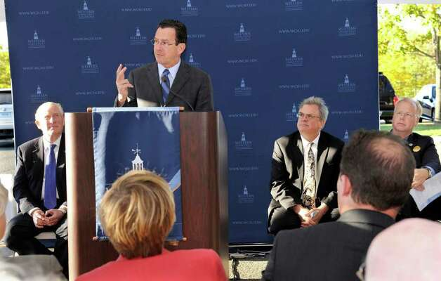 Gov. Dannel P. Malloy addresses an audience Monday at the groundbreaking ceremonies for the School of Visual & Performing Arts Center at Western Connecticut State University. From left are James W. Schmotter, WestConn president, Dr. Daniel Goble, dean of the School of Visual & Performing Arts; and Danbury Mayor Mark Boughton. Photo taken Monday, Oct. 17, 2011. Photo: Carol Kaliff