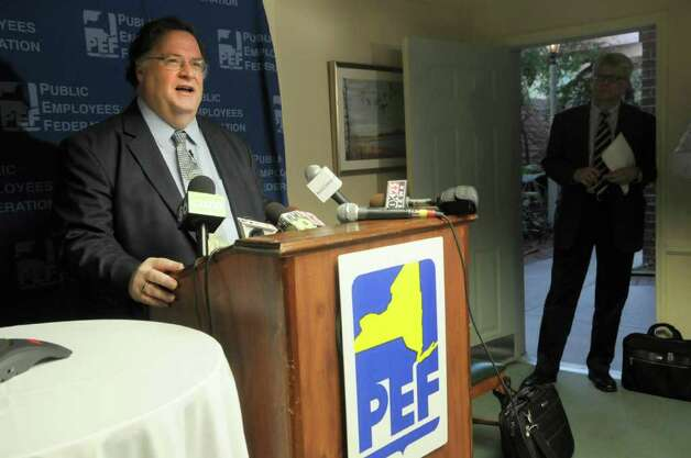 Ken Brynien, PEF president, addresses members of the media during a press conference following a meeting of the PEF executive board at The Desmond on Monday, Oct. 17, 2011 in Colonie.  The executive board approved to send a revised  contract negotiated with the State to its members for a vote.  (Paul Buckowski / Times Union) Photo: Paul Buckowski / 00015003A