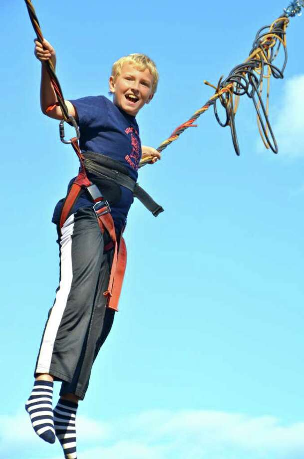 Nine-year-old Henry Selvala flying high on the bungee ropes at the New Canaan Nature Center Fall Fair on Saturday, October 15, 2011. Photo: Jeanna Petersen Shepard
