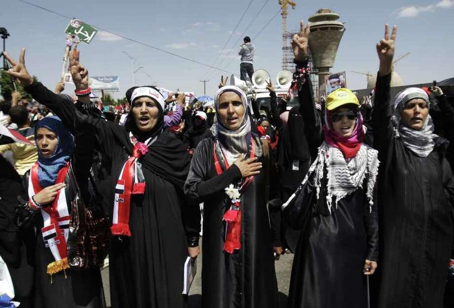 Female protestors chant slogans during a demonstration demanding the resignation of Yemen's President Ali Abdullah Saleh in Sanaa, Yemen, Monday, Oct. 17, 2011. (AP Photo/Hani Mohammed) Photo: Hani Mohammed / AP
