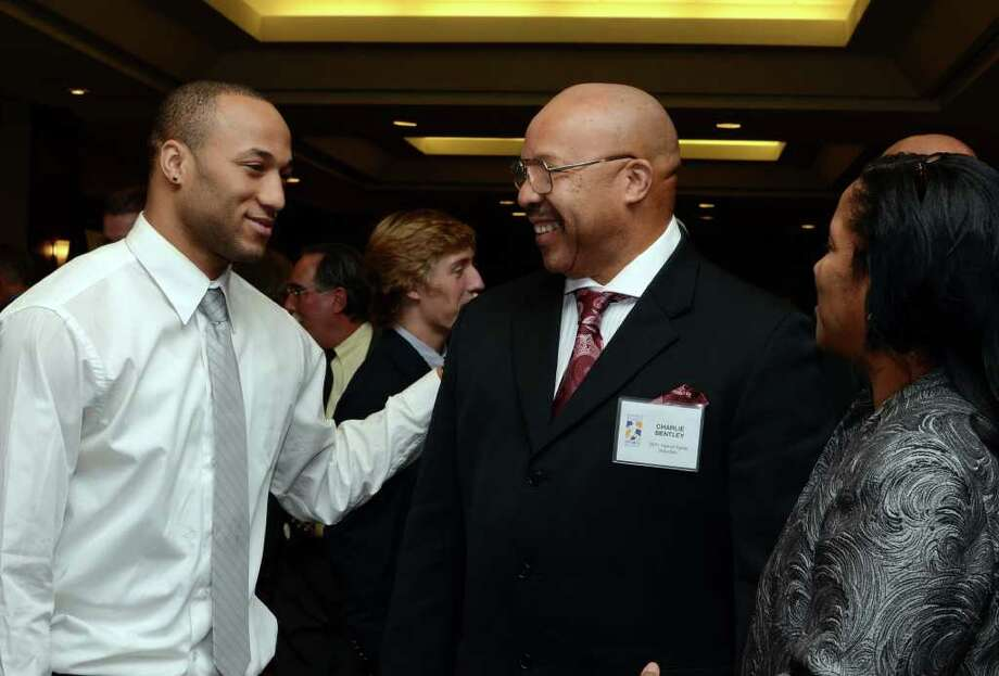 Charoy Bentley, at left, speaks with his father, Hall of Fame inductee, Charlie Bentley during the Fairfield County Hall of Fame dinner at the Greenwich Hyatt Regency on Monday, Oct. 17, 2011. Photo: Amy Mortensen / Connecticut Post Freelance