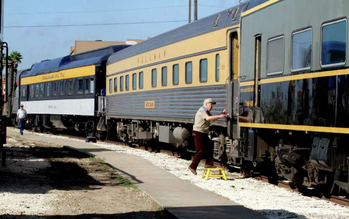 Charles Hatfield of Concord, California, who has 17 years of touring the country on trains, enters one of the eighteen historic passenger train cars at the Galveston Railroad Museum Monday, Oct. 17, 2011. With various owners, the cars have a combined value of $25 million. The train cars have been used by Presidents Truman, George H. W. Bush, Clinton and Obama as well as professional sports figures and celebrities. The train is traveling to the American Association of Private Railroad Car Owners convention in Kansas City.