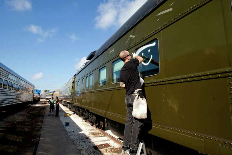 Grant Elliott, a porter with the Santa Fe 56 train car, cleans the windows of the historic passenger car. The Santa Fe 56 was built by Pullman as a business car for the Santa Fe Railway in 1923, and was originally assigned to the vice president of operations in Chicago. Its original road number was 34. in 1953 the car was modernized by lowering ceilings and updating the interior to make it more contemporary. Work was done at Santa Fe's Topeka shops. in 1973 the car was again rebuilt by the Santa Fe in Fort Worth and renumbered 56. The car is owned by Tom Hoback, Founder and CEO of Indiana Railroad and is frequently used as its business car on its routes between Chicago, Indianapolis, Louisville and central Illinois. The car has never been out of Santa Fe marks and represents the car as used in the 1950s. Photo: For To Chronicle :Thomas B. Shea