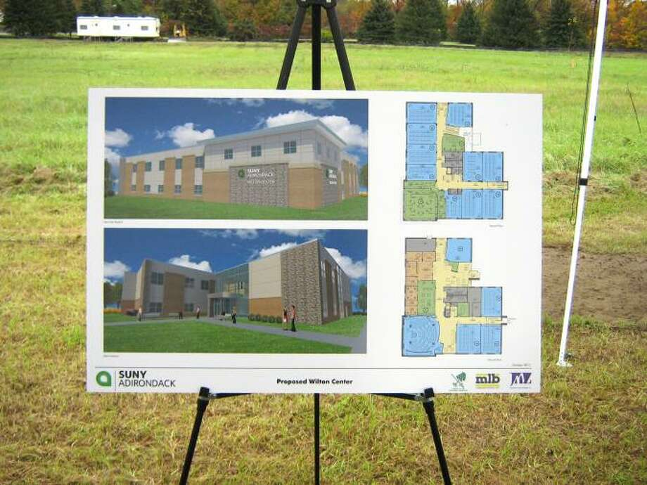 An easel holds a rendering of a new building to house the southern campus of SUNY Adirondack, the Wilton Center, during the groundbreaking ceremony. (SUNY Adirondack photo)