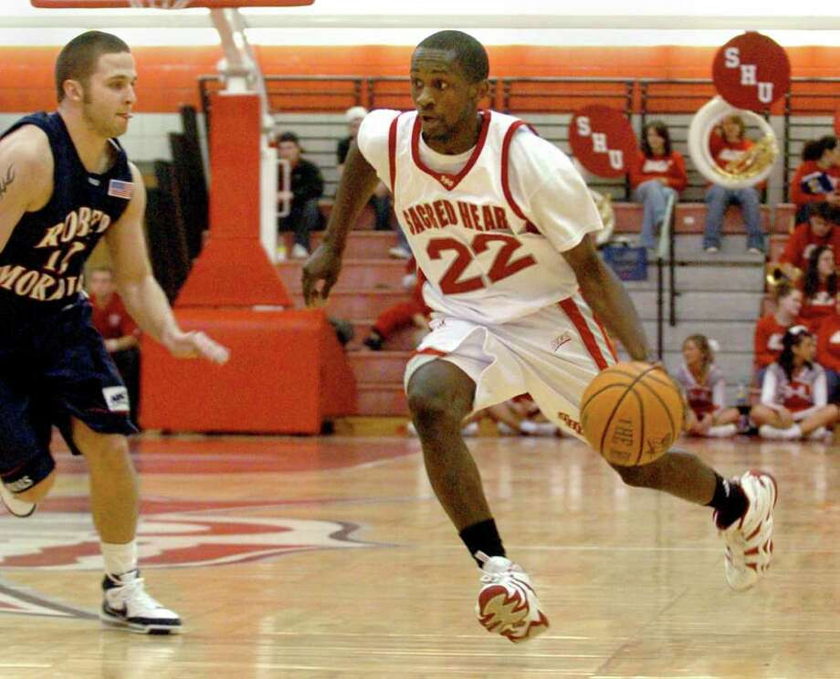 Sacred Heart University's Chauncey Hardy, right, in action against Robert Morris University Fairfield, Conn. Feb. 28th, 2008. Hardy died Saturday, Oct. 8th, 2011 after repeated blows to the head after an incident at a Romanian bar. Hardy played for CSS Giurgiu in southern Romania and was celebrating a victory over rival Dinamo Bucharest in Giurgiu. Photo: Christian Abraham / Connecticut Post