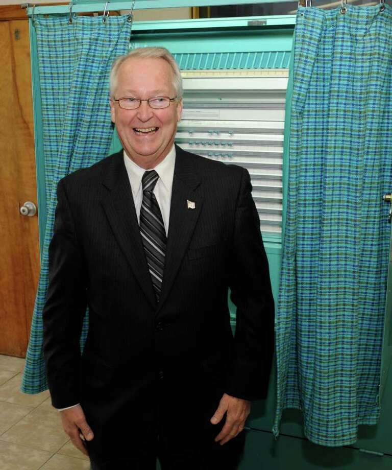 SKIP DICKSTEIN/TIMES UNION -  Congressional hopeful Jim Buhrmaster casts ballot at St. Joseph's Parish Center in Glenville, New York November 4, 2008. Photo: SKIP DICKSTEIN / 0001060A