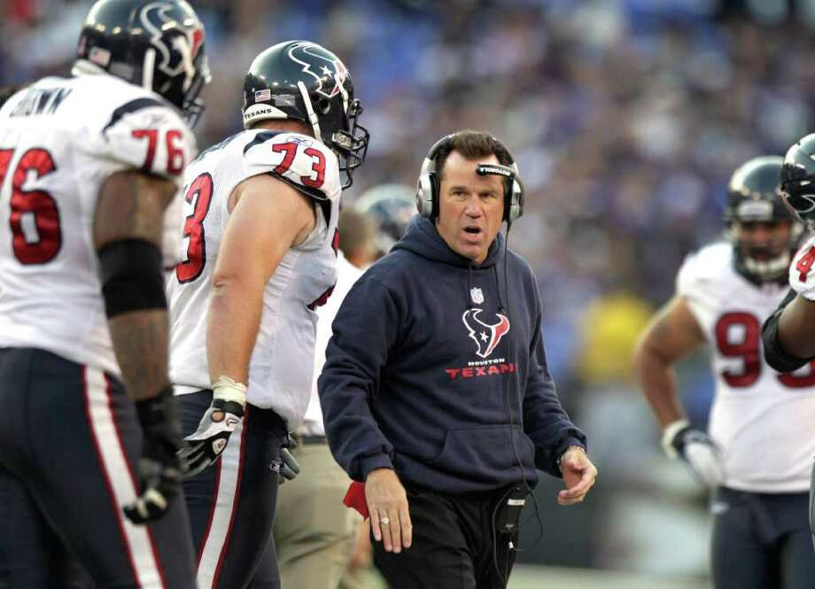 FRUSTRATED: Texans coach Gary Kubiak, right, says his team tends to lose something between practice and Sundays. Photo: Brett Coomer / © 2011  Houston Chronicle