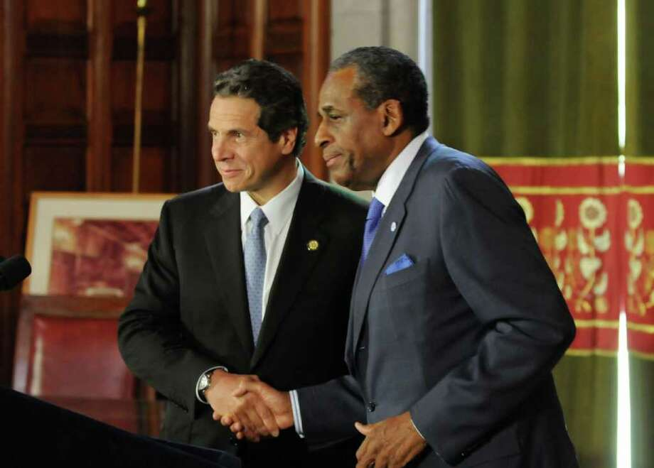 Gov. Andrew Cuomo, left, named H. Carl McCall, right, as his pick for chairman of the SUNY Board of Trustees during an announcement at the Capitol Monday, Oct. 17, 2011. McCall will succeed Carl Hayden as chair of the board. (Will Waldron / Times Union) Photo: Will Waldron
