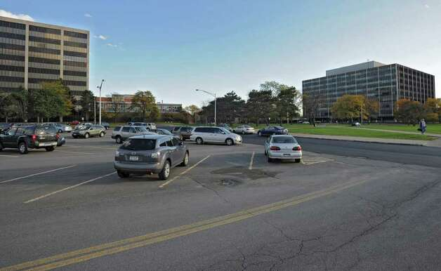 State workers leave work at the Harriman Campus in Albany, N.Y. Monday Oct. 17, 2011. Lori Van Buren / Times Union) Photo: Lori Van Buren
