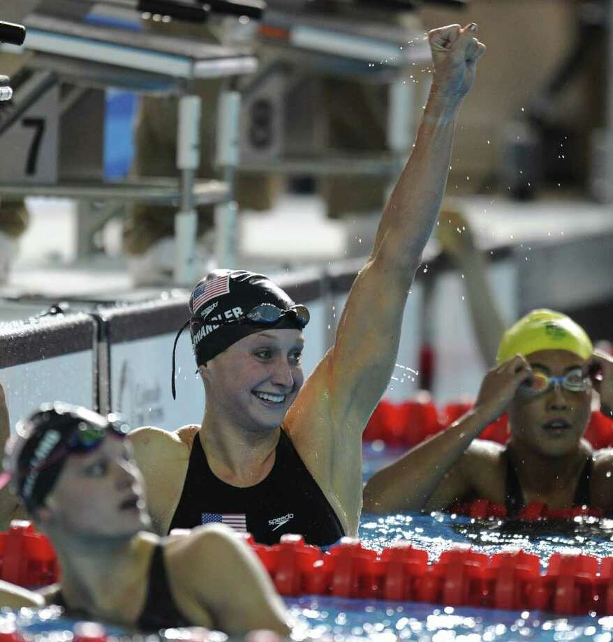 Annie Chandler (center), a Churchill High graduate, celebrates her victory in the 100-meter breaststroke. Photo: Francois Xavier Marit/Getty Images / 2011 AFP