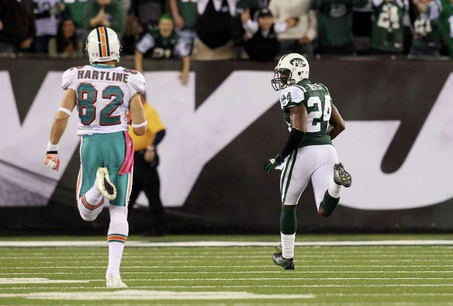 Oct. 17: Jets 24, Dolphins 6. Darrelle Revis of the New York Jets scores a touchdown on a first-quarter interception against the Miami Dolphins at MetLife Stadium in East Rutherford, New Jersey, Monday, October 17, 2011. Photo: Jim McIsaac, McClatchy-Tribune News Service / Newsday