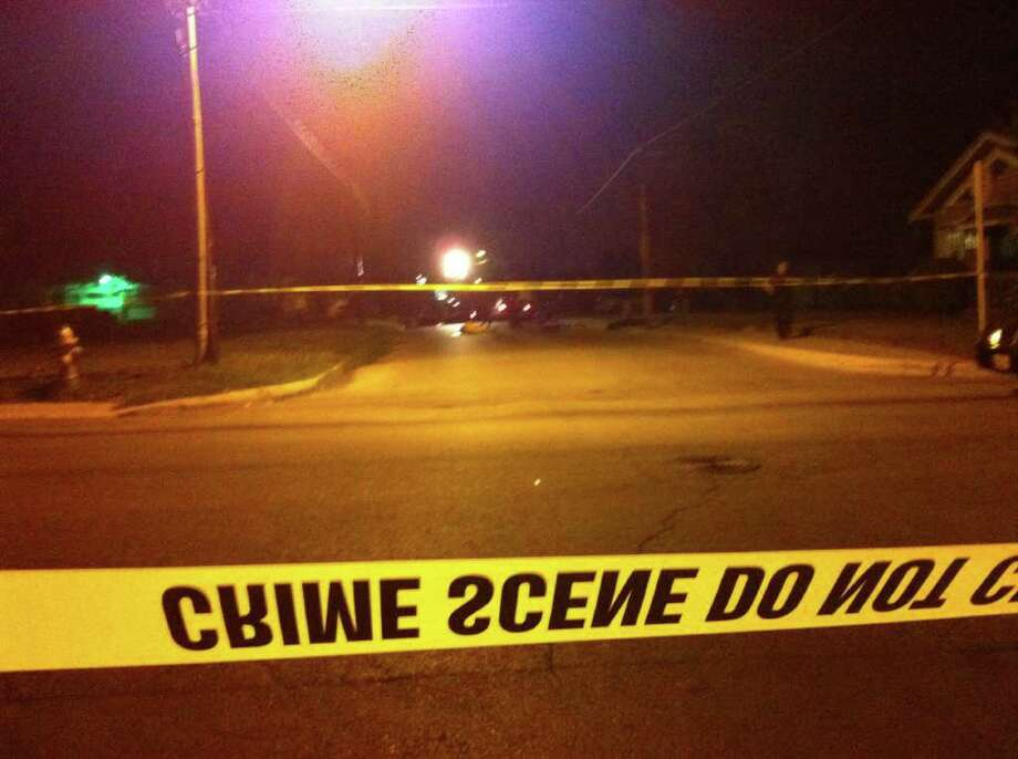 After responding to calls for shots fired at multiple locations in the East Side, San Antonio police found a man dead with a gunshot wound in the head in the 700 block of Gulf Street. Photo: Jessica Kwong/jkwong@express-news.net
