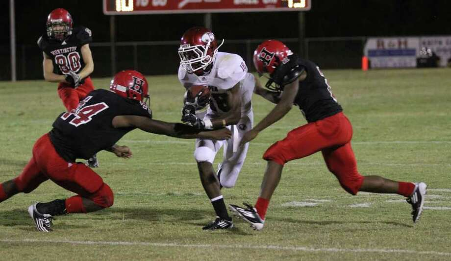 DeMarcus Collins looks for running room after making a short catch against Huntington. Photo: Jason Dunn
