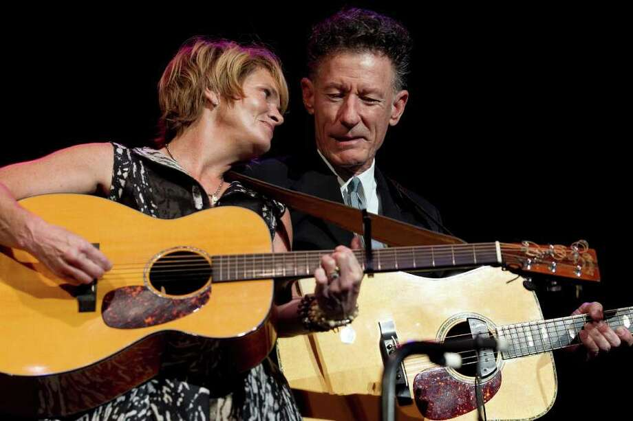 Deborah Cannon/AMERICAN-STATESMAN  Shawn Colvin sings with Lyle Lovett at Fire Relief The Concert for Central Texas at the Frank Erwin Center on Monday, October 17, 2011.
