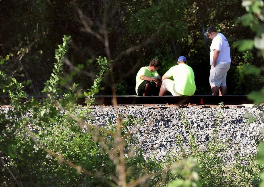 Vidor students mourn the loss of Matt Thomas on the train tracks Monday where the young man was killed early Sunday morning. Photo taken Monday, October 17, 2011. Guiseppe Barranco/The Enterprise