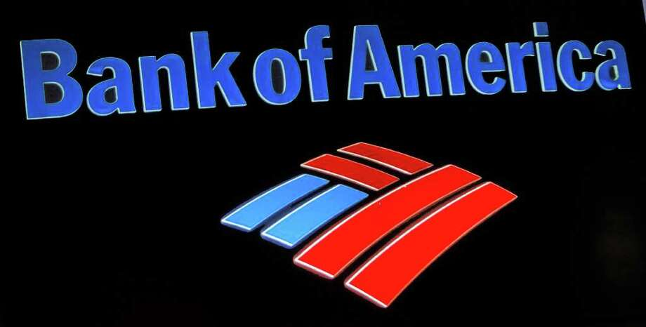 This photo taken Friday, Oct. 14, 2011, shows the Bank of America logo at a local branch office in Hialeah, Fla. Bank of America said Tuesday, Oct. 18, 2011, it earned $6.2 billion in the third-quarter largely from accounting gains and the sale of a stake in a Chinese bank. (AP Photo/Alan Diaz) Photo: Alan Diaz / AP