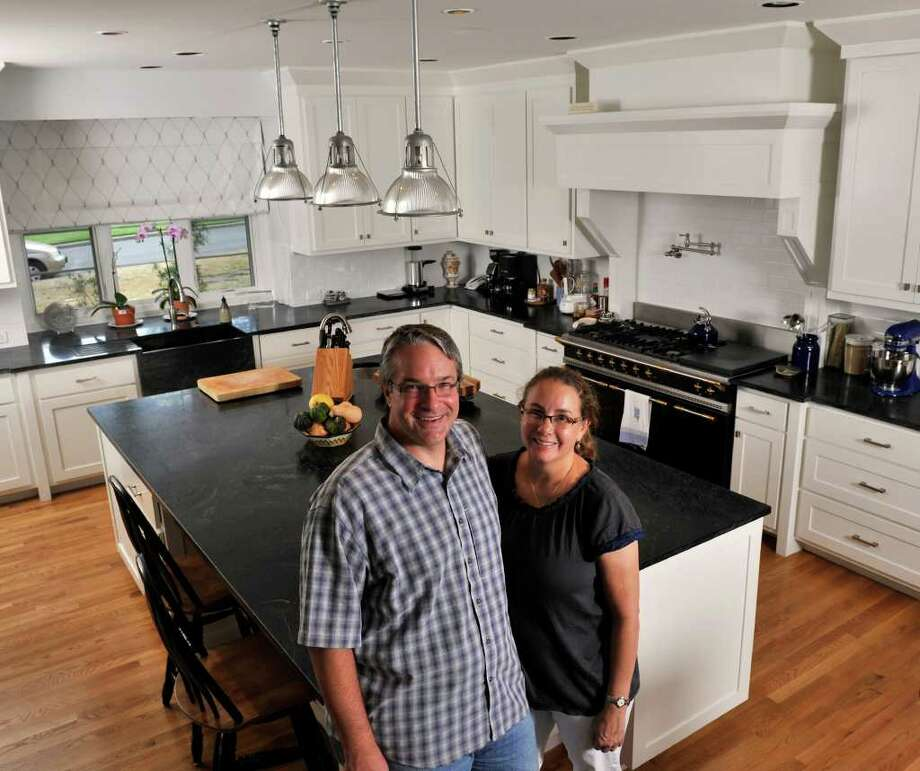 Troy and Pamela Toman chose a black-and-white theme for the kitchen of their Olmos Park home. Troy chose the Lacanche duel-fuel range. Photo: Photo By Robin Jerstad/Special To The Express-News