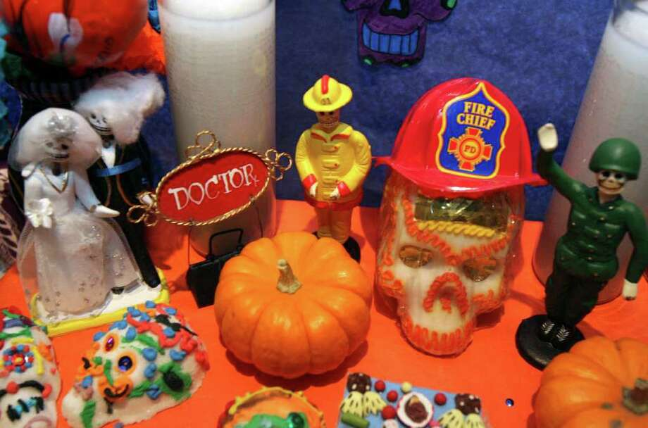 A detail of an altar dedicated to departed Heroes was constructed by students of Woodridge Elementary.  Students, teachers and parents construct altars at Paloma Blanca restaurant in Alamo Heights for Dia de los Muertos between students from Cambridge Elementary, St. Peters Prince of the Apostles Elementary and Woodridge Elementary.  Photo: ROBERT MCLEROY, SAN ANTONIO EXPRESS-NEWS / San Antonio Express-News