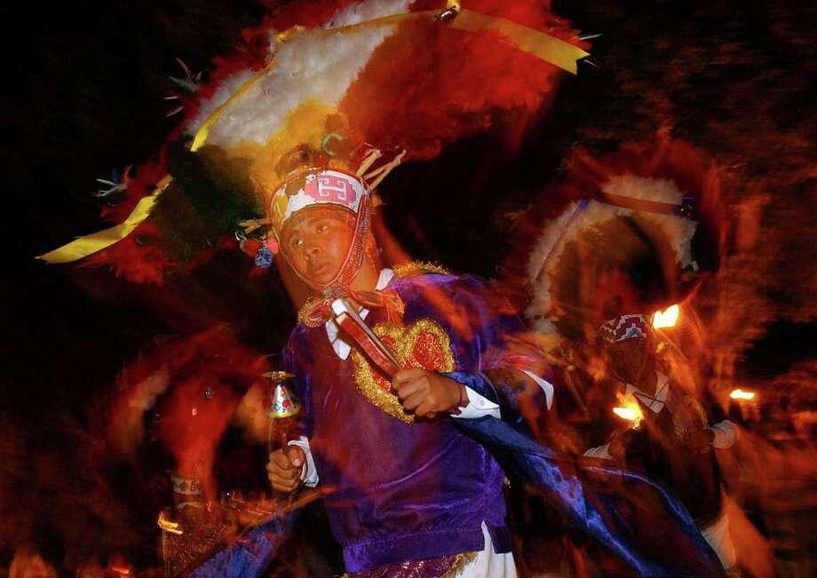 Students perform a traditional dance during Dia De Los Muertos celebrations held Monday Oct. 31, 2005  Xoxocotlan, Oaxaca, Mexico.  Photo: EDWARD A. ORNELAS, SAN ANTONIO EXPRESS-NEWS / SAN ANTONIO EXPRESS-NEWS