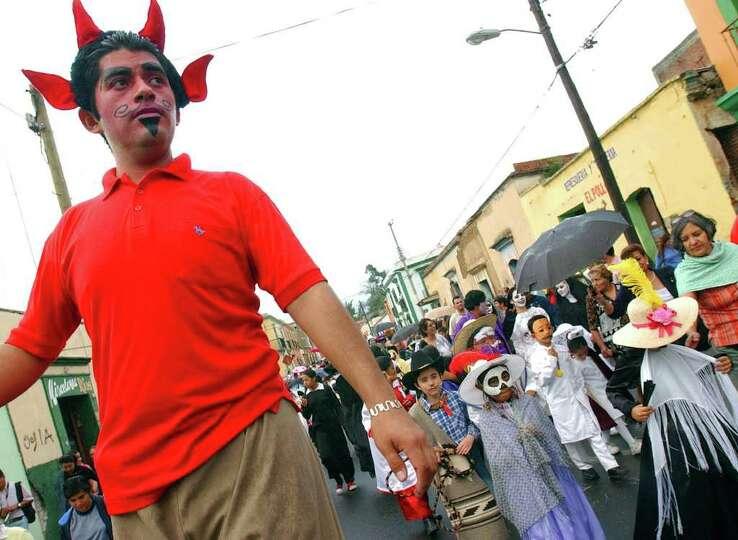 Oaxaquenos parade through the city Friday Oct. 28, 2005 in Oaxaca City, Oaxaca, Mexico during Dia De