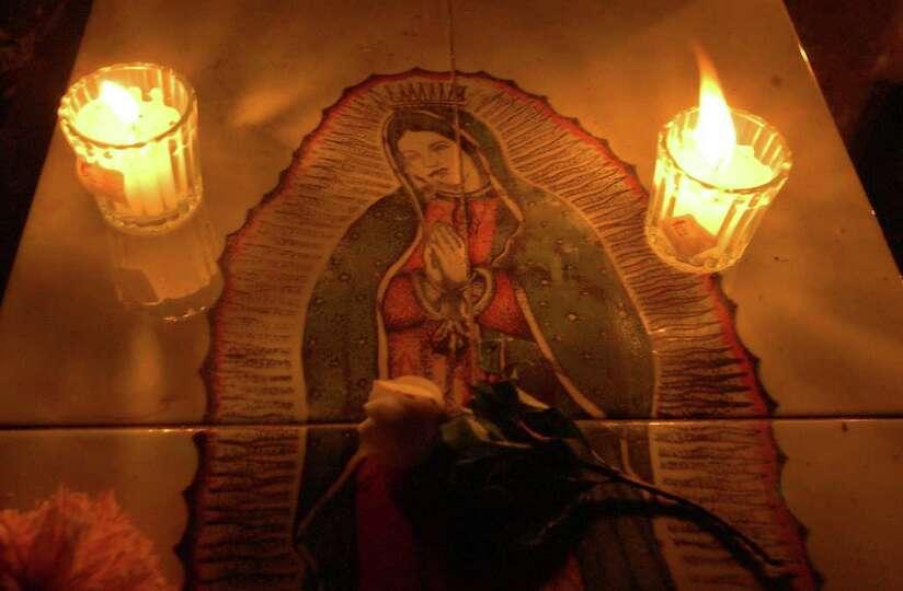 Candles illumate a headstone Tuesday Nov. 1, 2005 at the Panteon San Sebastian in Xoxocotlan, Oaxaca