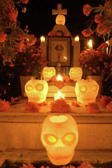 A section of a grave decortated with calaveras Monday Oct. 31, 2005 in the Panteon Municipal in Xoxo