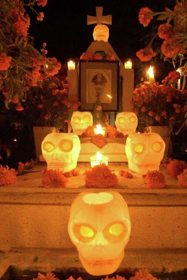A section of a grave decortated with calaveras Monday Oct. 31, 2005 in the Panteon Municipal in Xoxocotlan, Oaxaca, Mexico during Dia De Los Muertos celebrations.  Photo: EDWARD A. ORNELAS, SAN ANTONIO EXPRESS-NEWS / SAN ANTONIO EXPRESS-NEWS