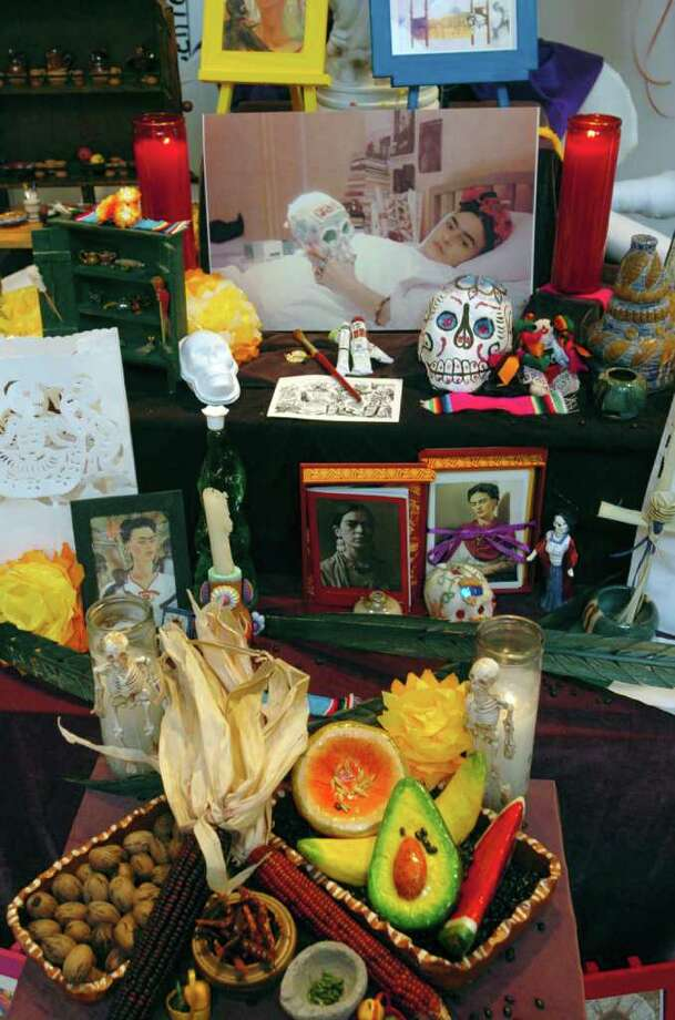 Current exhibit at the Galeria Guadalupe large collection of colorful Dia De Los Muertos altars designed by local elementary school students.  Photo: DELCIA LOPEZ, SAN ANTONIO EXPRESS-NEWS / SAN ANTONIO EXPRESS-NEWS
