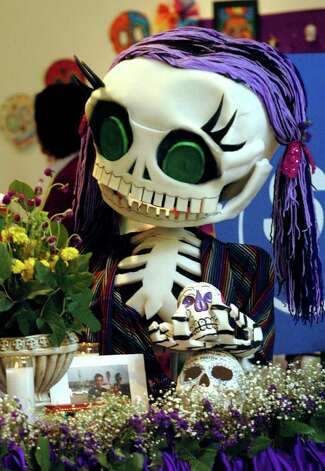 SA LIFE/ADVANCE/ FOR ELAINE AYALA: Current exhibit at the Galeria Guadalupe large collection of colorful Dia De Los Muertos altars designed by local elementary school students. DELCIA LOPEZ/STAFF Photo: DELCIA LOPEZ, SAN ANTONIO EXPRESS-NEWS / SAN ANTONIO EXPRESS-NEWS