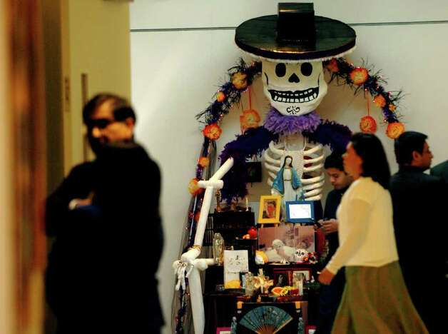 "STATE/DAILY/ Guadalupe Cultural Arts Center: The Galeria Guadalupe visual arts school and gallery opened its doors Wednesday Oct.26, 2005 as folks were treated to ""Dia De los Muertos"" altars made by school children on display entrance. DELCIA LOPEZ/STAFF Photo: DELCIA LOPEZ, SAN ANTONIO EXPRESS-NEWS / SAN ANTONIO EXPRESS-NEWS"