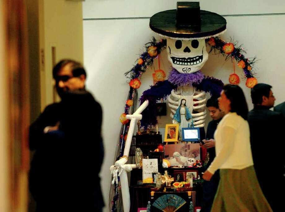 "The Galeria Guadalupe visual arts school and gallery opened its doors Wednesday Oct.26, 2005 as folks were treated to ""Dia De los Muertos"" altars made by school children on display entrance.  Photo: DELCIA LOPEZ, SAN ANTONIO EXPRESS-NEWS / SAN ANTONIO EXPRESS-NEWS"