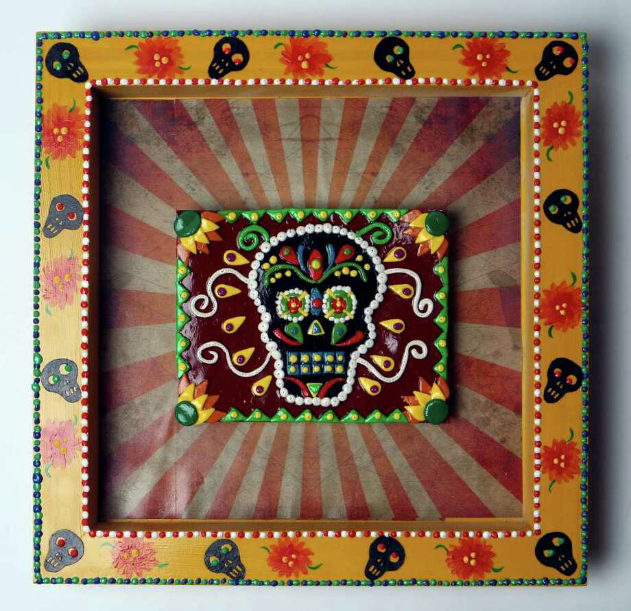 Cover art for Dia de los Muertos by Imelda Robles. Photo: HELEN L. MONTOYA, SAN ANTONIO EXPRESS-NEWS / hmontoya@express-news.net