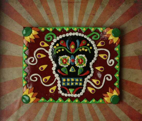 CONEXION: Cover art for Dia de los Muertos by Imelda Robles. Photo: HELEN L. MONTOYA, SAN ANTONIO EXPRESS-NEWS / hmontoya@express-news.net