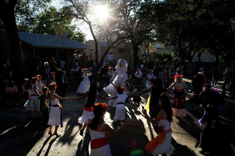 The Las Monas Drum and Dance group and Austin Samba School dance during the Dia de los Muertos celeb